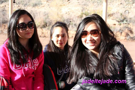 Three pretty ladies from Indonesia, together on the boat ride at the Colorado River, Grand Canyon